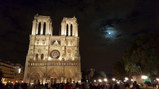 Notre Dame on a cloudy night.