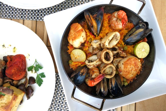 Paella del Mar- saffron rice, scallop black tiger shrimp, calamari, mussels. Beautiful presentation. Squeeze some lime on it and the rice + seafood flavors work together gorgeously. This would be a great dish to share because it's a lot of food.