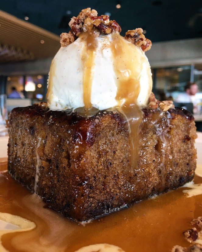Sticky Toffee Pudding- nutritional information warm, with candied pecans, buttery caramel sauce, bourbon crème anglaise & vanilla bean ice cream. A behemoth of a dessert. You'll definitely want to share this one. $9