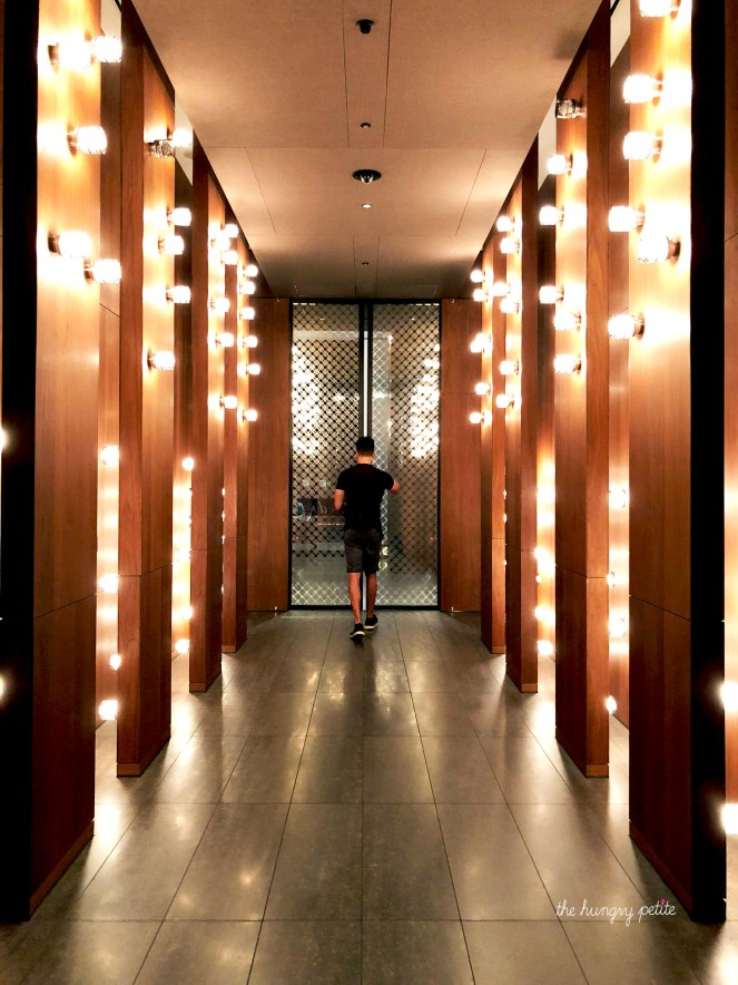 The Andaz Tokyo is inside the Toranomon Hills building. The building is home to business offices, restaurants, and retail space. After you pass through a glass sliding door, this is the hallway to the Andaz elevator.