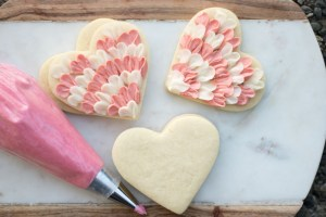 buttercream frosted heart cookies for valentines day