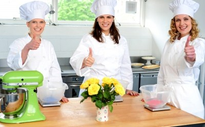 Food service - chefs giving the thumbs up in a restaurant kitchen