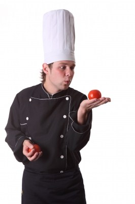 Food service - Chef looking at a tomato