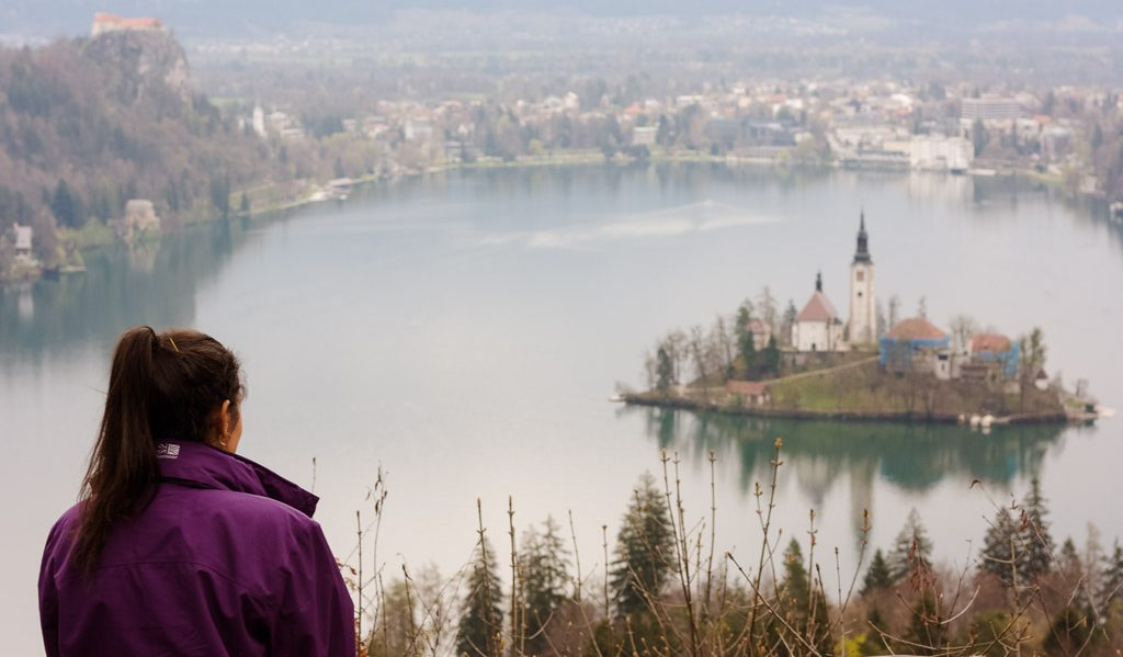 Girl looking out over Lake Bled in Slovenia from a viewpoint