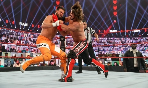 WWE Styles and Omos