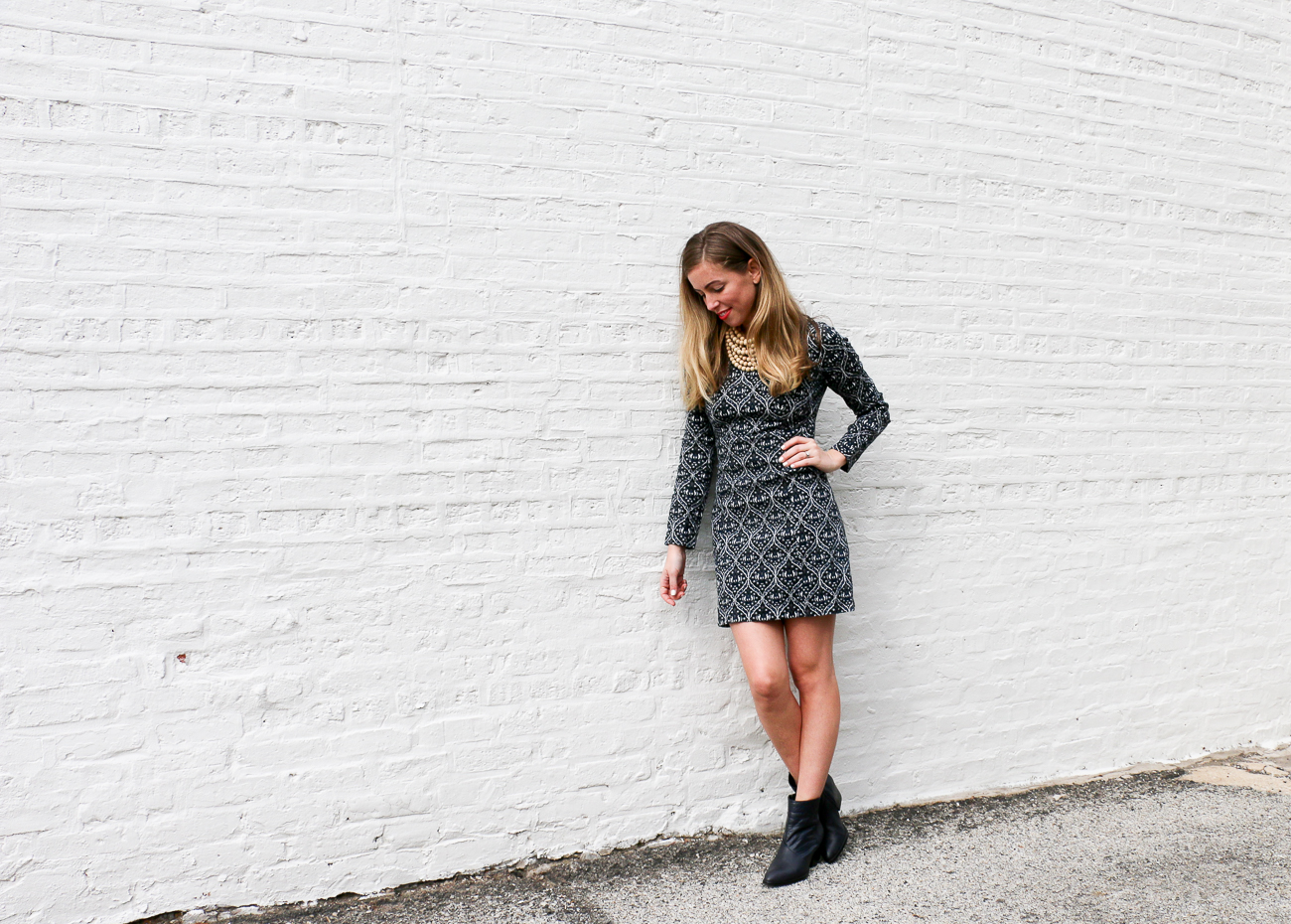 Blue pattern dress, white wall