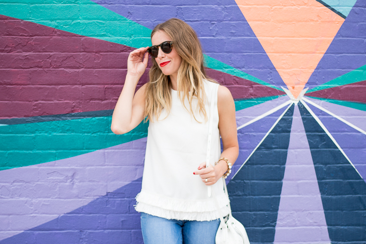 White fringe shirt, bright wall
