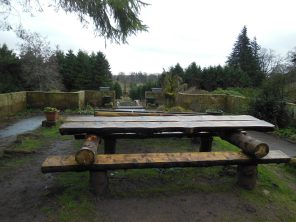 Picnic table at the top of the staircase.