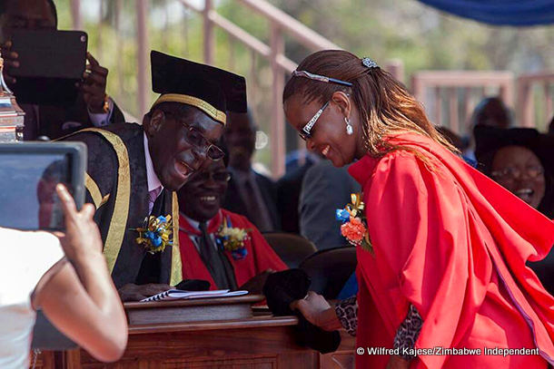 President Robert Mugabe shares a joke with his wife Grace who graduated with a doctorate of philosophy degree at the University of Zimbabwe late last year.