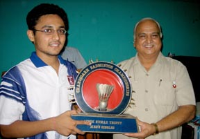 Men's singles champion Oscar Bansal receiving trophy from Chandigarh Badminton Association president MC Sethi on Wednesday.
