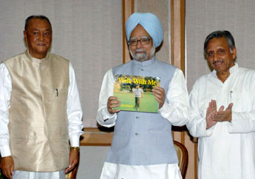 The Prime Minister, Dr. Manmohan Singh, launching a book entitled 'Walk with Me' by the Union Minister of Tribal Affairs, Shri P.R. Kyndiah, in New Delhi on September 02, 2008. The Union Minister for Panchayati Raj and Development of North Eastern Region, Shri Mani Shankar Aiyar is also seen.