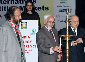 """The Vice President, Shri Mohd. Hamid Ansari lighting the lamp to inaugurate the """"India Energy Conference-Oil, Gas and Alternatives"""", organised by the Energy and Resources Institute (TERI), in New Delhi on October 03, 2008. The Director General, The Energy and Resources Institute (TERI), Dr. R K Pachauri, is also seen."""