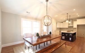 kitchen with farmtable and custom island light fixture