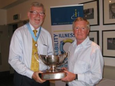 Allen Prior presents the Julius Neave Trophy to winner Barry Crutchley.