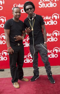 J.A (right) with his manager Dennis Munene