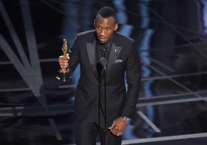 """Mahershala Ali accepts the award for best actor in a supporting role for """"Moonlight"""" at the Oscars on Sunday, Feb. 26, 2017, at the Dolby Theatre in Los Angeles."""