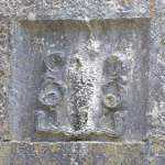 Carving of a creature in the wall of Kilnaboy Church - The Irish Place