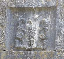 The carving of a creature in the wall of Kilnaboy Church. - The Irish Place