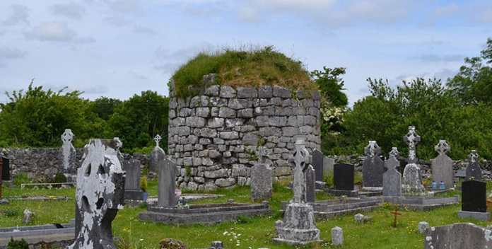 The stump of the round tower destroyed by Cromwell's forces at Kilnaboy Church - The Irish Place