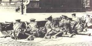 British troops with Lee Enfield rifles and a Lewis gun in Dublin in 1916.
