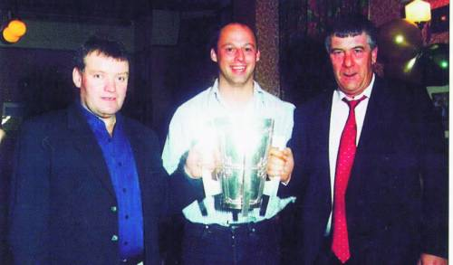 Andy pictured with Kevin Murphy and Denis Regan of Brothers Pearse in 2002, the year he was All-Ireland-winning captain