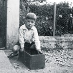 Seán, aged around six, at his father's former home in Adrigole, west Cork, with his favourite toy – with a bit of imagination, it could be anything. taken from  An Poc Ar Buile – The Life & Times of Seán Ó Sé by Seán Ó Sé with Patricia Ahern, published by The Collins Press, 2015
