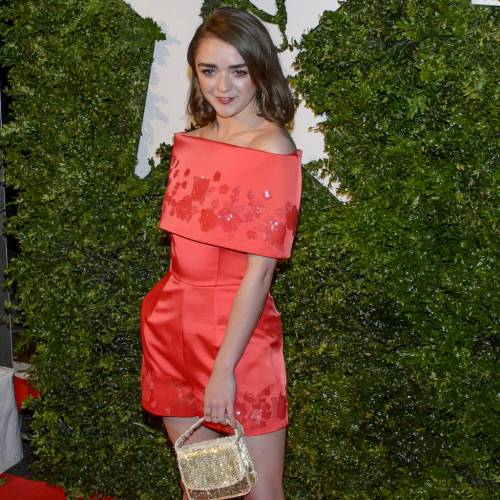 Maisie Williams wins the fashion Game in red romper at movie awards