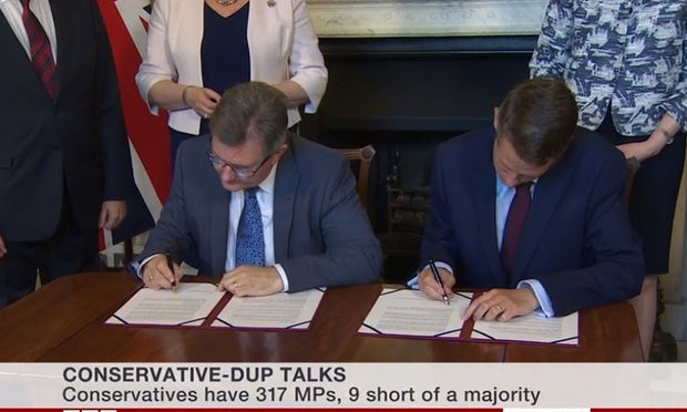 DUP agrees £1.5bn deal to support Theresa May's Conservative government