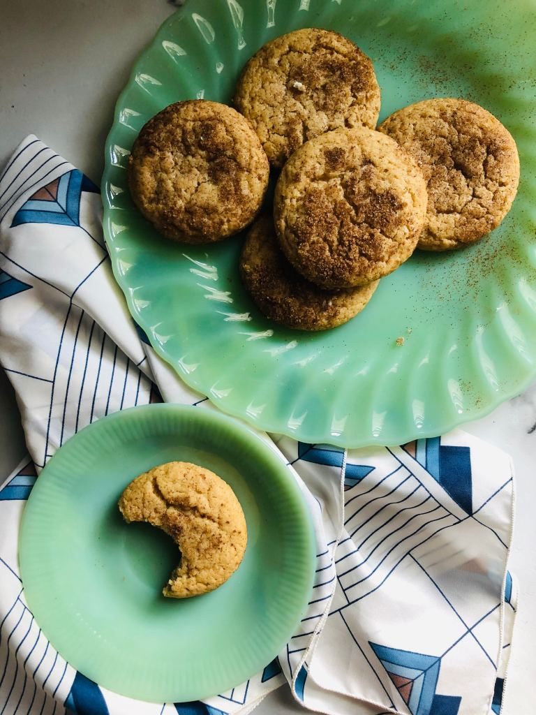 brown butter goat cheese cookies on swirled jade antique plate. scarf