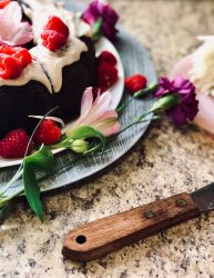 portrait shot tamarind fudge cake with raspberry garnish