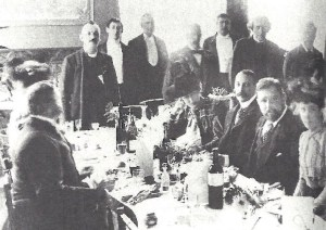 Henry Irving standing second from right. Bram Stoker seated second from right.