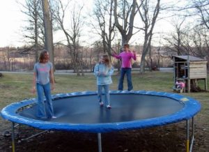 kids playing on trampoline