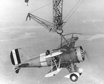 A Sparrowhawk fighter attached to the trapeze beneath Macon (1933)