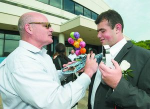 Harry Cohn adjusts his son's tie before he heads off to the WBHS prom.