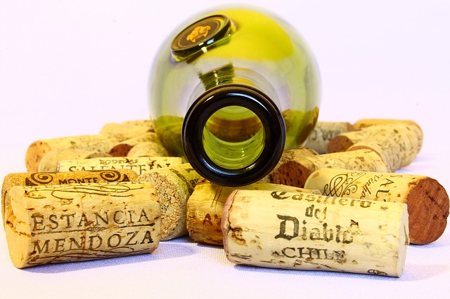 Empty wine bottle and corks
