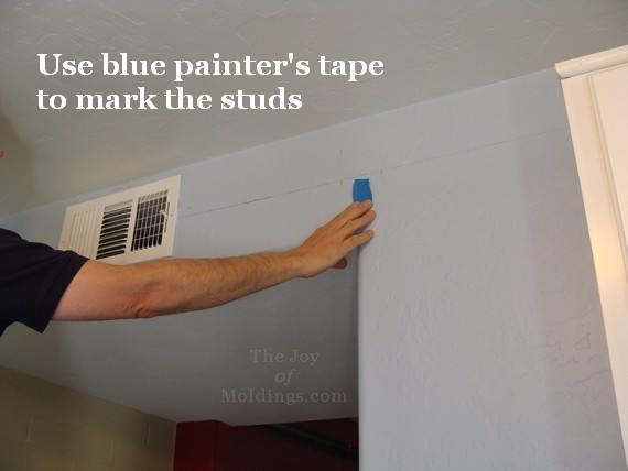 Blue tape for fast stud location when installing crown.