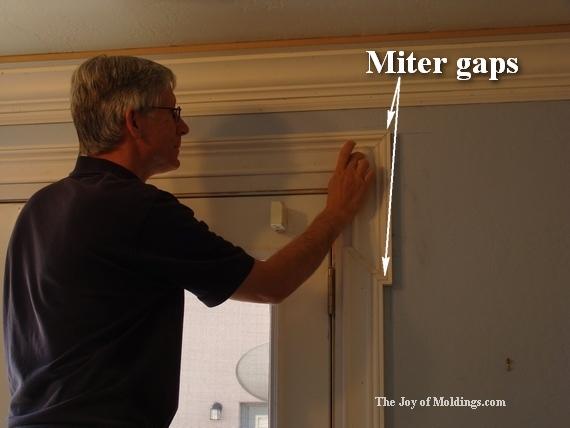 finish carpenter preparing moldings for paint