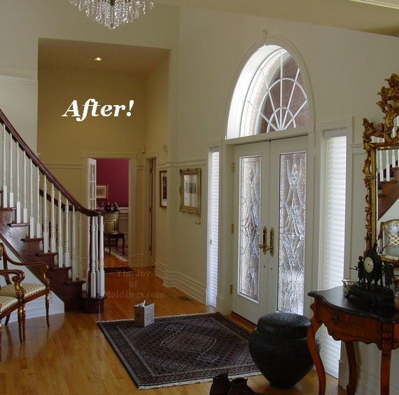 foyer front door open floor plan with half circle window