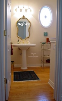 guest half bathroom baseboard with tall ceilings