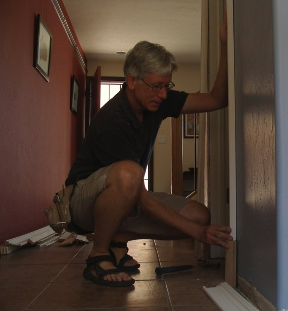 finish carpenter installing door trim