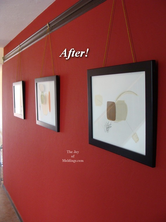 artwork hanging on picture rail molding