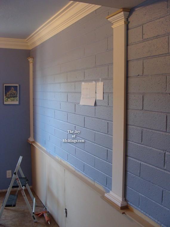 moldings on brick wall