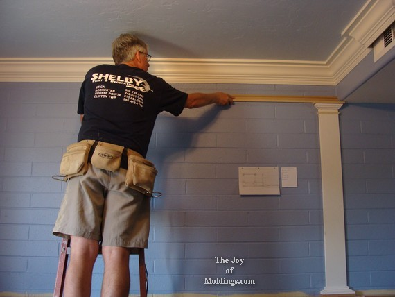how to install molding on brick wall