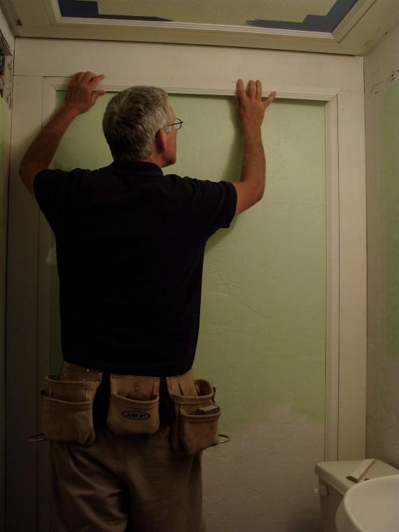 finish trim carpenter with tool belt