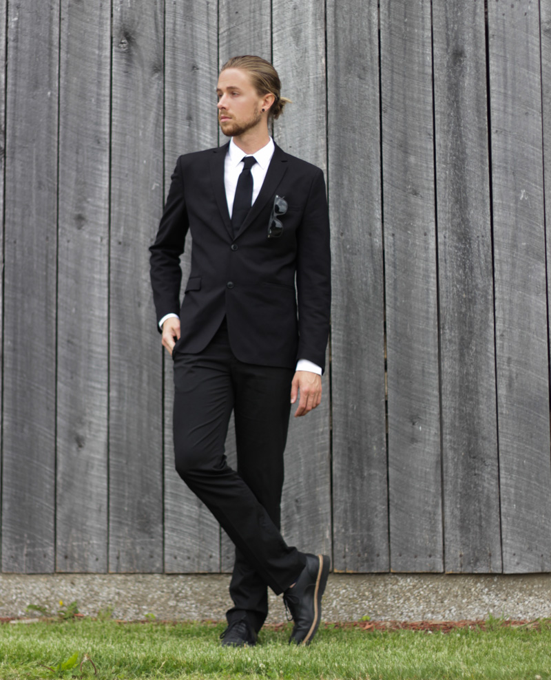 The Kentucky Gent in H&M Blazer, Calvin Klein Tie, Zara Oxford Shirt, Zara Black Slacks, Cole Haan Dress Shoes, Ray-Ban Wayfarers, and Soxy Socks.
