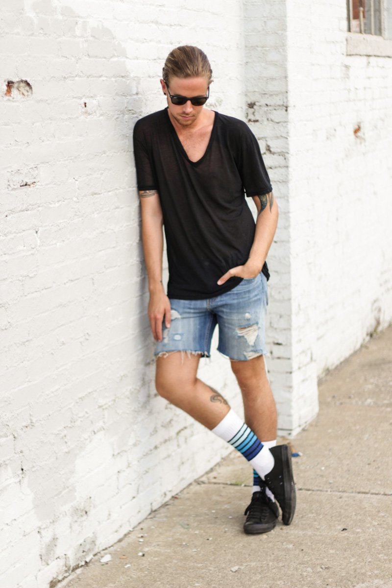 The Kentucky Gent in American Apparel V-Neck, Levi's Cut Off Shorts, Ray-Ban Wayfarers, Converse Chucks, and Richer Poorer Striped Athletic Socks.
