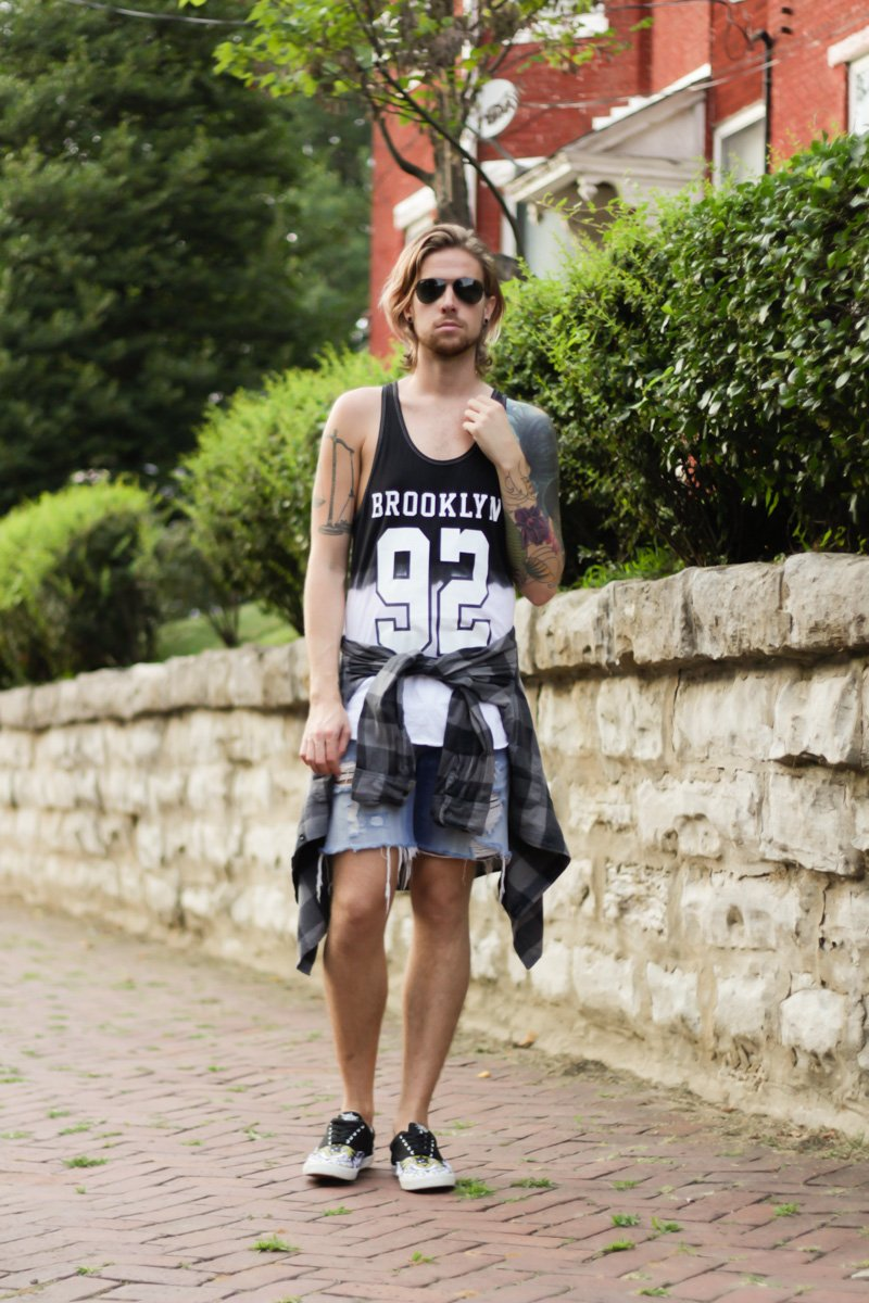 The Kentucky Gent, a southern men's life and style blogger, in Urban Outfitters Tank Top, Devil's Harvest Plaid Shirt, Levi's Cut Off Denim Shorts, Bucketfeet Sneakers, and Ray-Ban Aviators from East Dane.