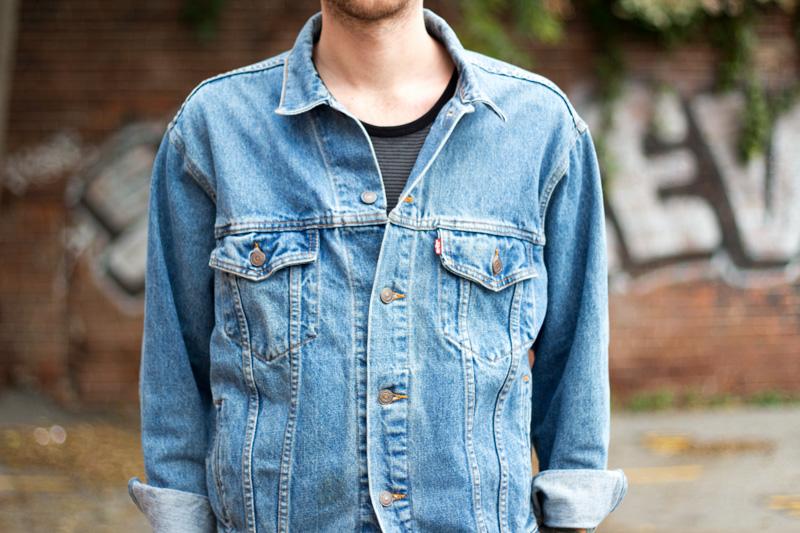 The Kentucky Gent, a men's fashion and lifestyle blogger, in Levi's Denim Trucker Jacket, Kill City T-Shirt, Zanerobe Mesh Joggers, Converse Chuck Taylors, and Ray-Ban Aviator Sunglasses.