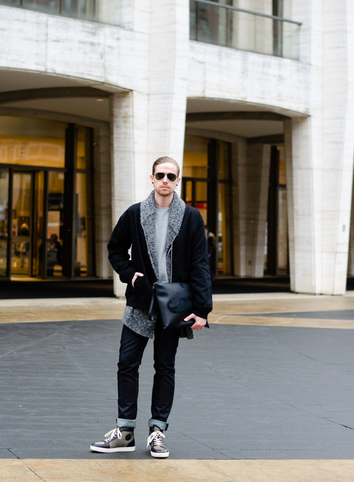 The Kentucky Gent, a men's fashion and lifestyle blogger, spends his first day of NYFW at Lincoln Center in Christian Louboutin sneakers and bag.The Kentucky Gent, a men's fashion and lifestyle blogger, spends his first day of NYFW at Lincoln Center in Christian Louboutin sneakers and bag.