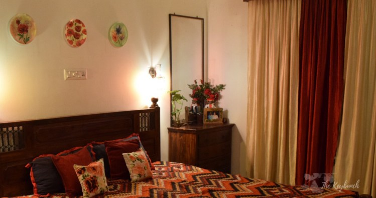 Home decor Tour by Ankita and Sitanshu's in Lucknow - The bedroom decorated with wall plates and chest of drawers